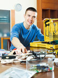 Happy smiling guy showing toolbox Stock Photography