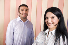 Happy smiling helpdesk team. Happy smiling two helpdesk team,focus on man smile.Check also,for pictures similar or the same series Royalty Free Stock Photo