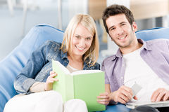 Happy smiling high-school students listen music Stock Image