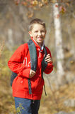 Happy smiling hiker boy with backpack Stock Photo