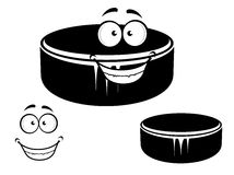 Happy smiling hockey puck Stock Images