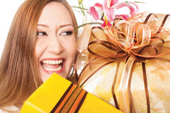 Happy smiling holiday gifts presents. Smiling woman, holding gift boxes on white background Stock Image