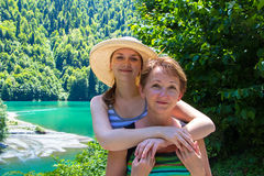 Happy smiling hugging tourists Royalty Free Stock Photo