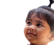 Happy smiling indian kid or child smiling and looking up stock image