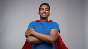 Happy smiling indian man in red superhero cape stock video