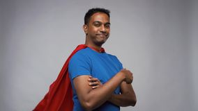 Happy smiling indian man in red superhero cape stock footage