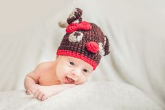 Happy smiling infant baby boy portrait dressed in christmas deer. Crocheted hat, winter holidays concept Royalty Free Stock Photos