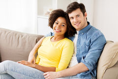 Happy smiling international couple at home Royalty Free Stock Image