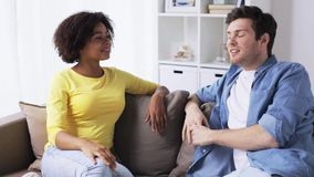 Happy smiling international couple talking at home stock footage