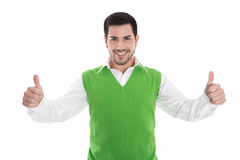 Happy smiling and isolated man in green pullover with thumbs up Royalty Free Stock Photography