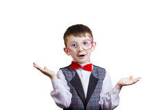 Happy smiling joyful little boy  nerd with glasses on his ears i Royalty Free Stock Images