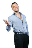 Smiling joyful man with mobile phone Stock Photography