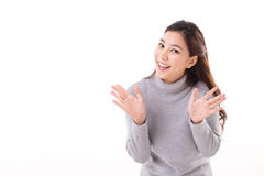 Happy, smiling, joyful woman wearing grey sweater. Showing her palm to you, happy pose Stock Images