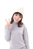 Happy, smiling, joyful woman wearing knit hat, showing 2 fingers. Hand sign Stock Photo