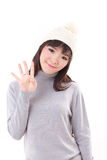 Happy, smiling, joyful woman wearing knit hat, showing 4 fingers. Hand sign Royalty Free Stock Photos