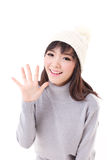Happy, smiling, joyful woman wearing knit hat, showing her palm Royalty Free Stock Photos