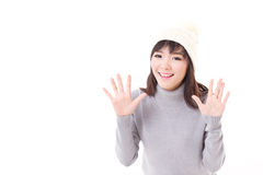 Happy, smiling, joyful woman wearing knit hat, showing her palm Royalty Free Stock Images