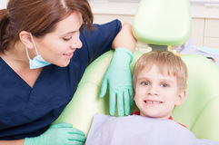 Happy and smiling kid at dentist with no fear Royalty Free Stock Images
