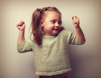 Happy smiling kid girl showing muscular and looking fun. Vintage Royalty Free Stock Photo