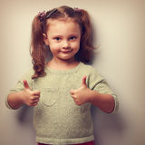 Happy smiling kid girl showing two hands thumb up. Vintage. Closeup portrait royalty free stock photography