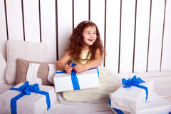 Happy smiling kid holding gifts. Christmas, New Year Royalty Free Stock Photos