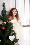Happy smiling kid near the Christmas tree. Royalty Free Stock Image