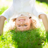 Active kid playing outdoors Royalty Free Stock Photo