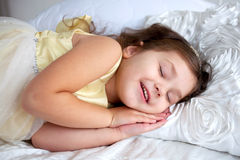 Happy smiling kid sleeping and smiling Stock Image