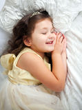 Happy smiling kid sleeping Stock Image