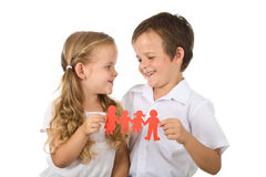 Happy smiling kids holding paper people - isolated. Happy kids holding paper people - united family concept, isolated royalty free stock image