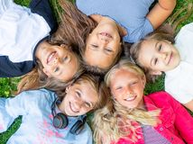 Happy Smiling Kids. Looking at the camera on the grass, topview royalty free stock image