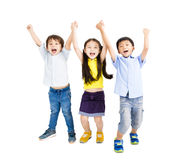 Happy smiling kids raise hands. Group of happy smiling kids raise hands Stock Photos