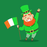 Happy Smiling Leprechaun holding Irish flag in his hand. Saint Patricks Day fairy tale colorful character Stock Photo