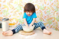 Happy smiling little boy baking Royalty Free Stock Image