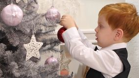 Happy smiling little boy decorated new year tree stock video footage