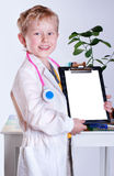 Happy smiling little boy in doctors uniform Royalty Free Stock Photography