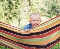 Happy smiling little boy portrait in hammock Stock Photo