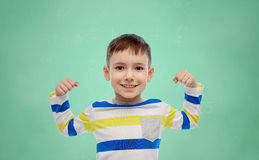 Happy smiling little boy with raised hand Royalty Free Stock Photo