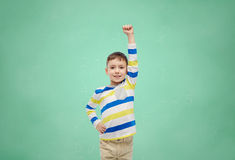 Happy smiling little boy with raised hand Royalty Free Stock Photography