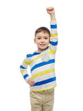 Happy smiling little boy with raised hand Stock Images