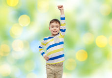 Happy smiling little boy with raised hand Stock Photo