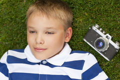 Happy smiling little boy with retro vintage camera Stock Photography