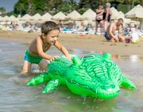 Happy smiling little boy run play with waves on beach. Italy. Summer. Se Royalty Free Stock Image