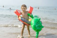 Happy smiling little boy run play with waves on beach. Italy. Summer. Sea Royalty Free Stock Photos