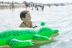 Happy smiling little boy run play with waves on beach. Italy. Summer. Sea Stock Image