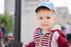 Happy smiling little boyl on playground Stock Photos