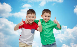 Happy smiling little boys showing thumbs up Royalty Free Stock Photo