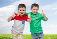 Happy smiling little boys showing thumbs up Royalty Free Stock Images