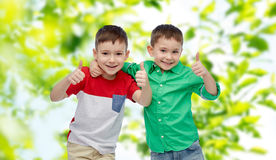 Happy smiling little boys showing thumbs up Stock Photo