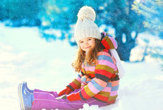 Happy smiling little child playing on snow in winter Royalty Free Stock Image